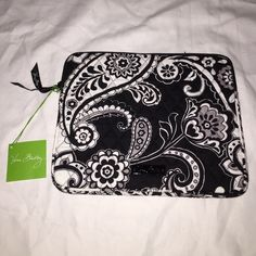 "NWT Vera Bradley Tablet Sleeve in Midnight Paisley DESCRIPTION An update on a true tech favorite, our softly padded tablet sleeve features a redesigned U-shaped zip opening that makes getting your tablet in and out even easier. A Vera Bradley logo plaque offers another fresh detail.  DETAILS & CARE TIPS Details Updated U-shaped zip-top opening Padded with lightweight protective foam Accommodates most tablets, including the iPad New logo plaque offers another fresh detail Dimensions 8 ¼"" W x…"