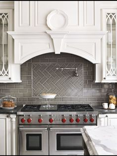 Gray Herringbone Tile Backsplash