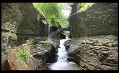 Watkins Glen State Park is a natural attraction located in Watkins Glen at the southern end of Seneca Lake. The main feature of the park is the hiking trail that climbs up through the gorge, passing over and under waterfalls. The park has a lower part that is next to the village and an upper part that is open woodland.  Watkins Glen State Park is in a 400-foot deep narrow gorge cut through rock by a stream when glaciers of the Ice age deepened the Seneca valley.