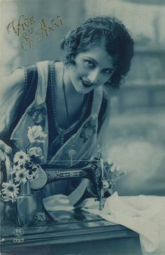 Vintage sewing postcard - lovely lady posing with sewing machine (postmarked 1925).