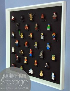 Turn a large picture frame with the glass removed into a DIY Lego Mini figure display.
