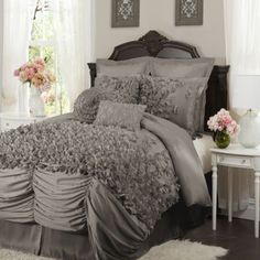 Lucia 4-Pc. Comforter Set. Too feminine for a couple for me, but if I were single, it'd be cute
