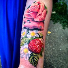 Most amazing strawberry tattoo ever! Done by Liz Venom at the best shop in Edmonton, Bombshell Tattoo Studio.
