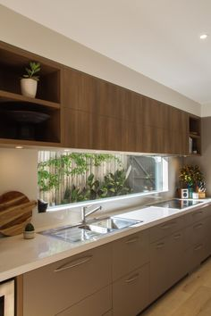 Large, modern, contemporary kitchen in warm tones with a huge island bench! www.thekitchendesigncentre.com.au @thekitchen_designcentre #cocinasrusticascemento