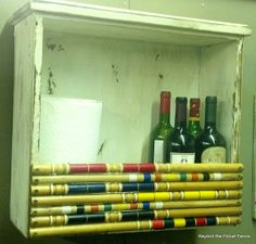 "Drawer Croquet - A shelf made out of an old drawer and several croquet mallet handles. Nice. (via a blog called ""Beyond the Picket Fence"")"