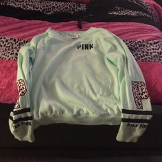 Cute PINK shirt  Mint green shirt with cheetah print on the sleeves. PINK by Victoria's Secret PINK Victoria's Secret Sweaters Crew & Scoop Necks