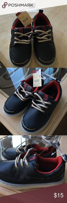Boy Oshkosh boat shoe Navy color. Lace tie. Never worn with tags Osh Kosh Shoes Dress Shoes