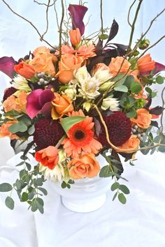 Pretty tangerine, orange, and burgundy centerpiece. Wedding Arrangements, Wedding Centerpieces, Floral Arrangements, Centrepieces, Country Wedding Dresses, Modest Wedding Dresses, Cheap Backyard Wedding, Table Lanterns, Mermaid Dresses