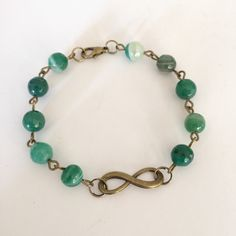 A personal favourite from my Etsy shop https://www.etsy.com/listing/230685851/faceted-green-agate-bronze-linked