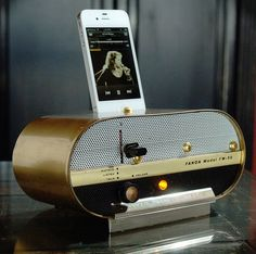 Originally a 1960's Fanon FW-50 wireless tube intercom turned into an iPod Dock, very much in the Mad Men style.