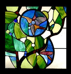 Floral stained glass composed of Tiffany glass