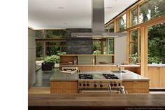 Woodway residence kitchen. Love that the kitchen cabinetry/counter carries on into the outdoor space