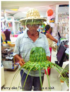 """""""Jungle"""" visits Commonwealth Fabrics with his straw hats!  He also buys a zipper too!"""