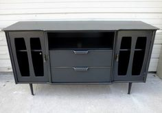 Mid-Century Modern Buffet repurposed into media console, on Facelift Furniture  http://faceliftfurniture.com/gallery/living-room-transformations/nggallery/page-2/#sg22