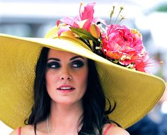 Kentucky Derby 2012 - Plenty of space:   Tamara Sorrell, from Austin, Texas, can create her own elbow room with this wide hat.