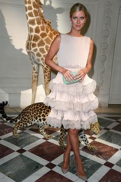 Nicky Hilton opted for a sweet tiered dress and seafoam clutch to outfit her perfectly for the Valentino Fall show.
