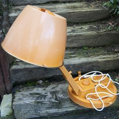 Vintage orange hair dryer in plastic from the french brand Calor. This hood dryer has a thermostat to adjust temperature and four height positions. Shop it on: boutsdartsvintage.etsy.com #lestrouvaillesdemathilde