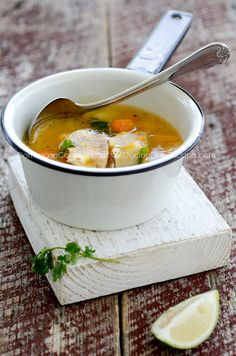 Sopa de Pescado (Fish Soup) 12 lbs of sea bass fillet (or other tropical fish) cut into small pieces 1 cup of auyama (West Indies pumpkin), diced 1 cup of potatoes, diced 1 large carrot, diced 1 qrt of vegetable or fish stock 2 tablespoons of olive oil 2 sprigs of cilantro 2 cloves of garlic, sliced Juice of 1 lime