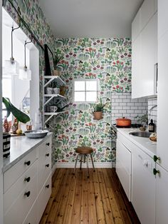 Gorgeous/kitschy colourful floral wallpaper juxtaposed with white subway tiles