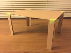 I made the 1:5 scale of the dining table to go along with my chair. I just made it out of a thin cardboard i got from work. It is just a simple table to show the scale of the chair.
