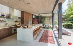 massive windows, impressive kitchen and beautiful outdoor area 634 Milwood Ave, Venice, CA 90291 Home Interior Design, House Design, Warm Living, House Plans, House Interior, Home, Kitchen Design, House Inspo, Indoor Outdoor Living