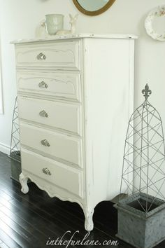 I cannot decide whether to paint my dressers white or black.   gurrrr. maybe grey