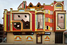 """Freddy Mamani Silvestre is known as the """"King of Andean Architecture,"""" and he has built dozens of houses boasting bright colors and patterned motifs that originate in indigenous art and architecture. The 36 indigenous cultures that represent almost 2/3 of the population are now becoming more prominent in Bolivia, and the wild so-called """"spaceship architecture"""" is an easy symbol for the rise of these native peoples.bolivia7"""