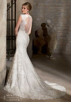 2717 Bridal Gowns / Dresses Embroidered Appliques on Net with Crystal Beading and Wide Hemline- Available in Three Lengths: 55 inches, 58 inches, 61 inches