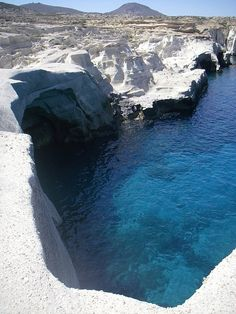 sapphire blue waters and snow white rocks, sarakiniko, milos, greece