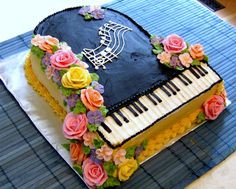 This is amazing!!! Its Buttercream Rose Piano Cake