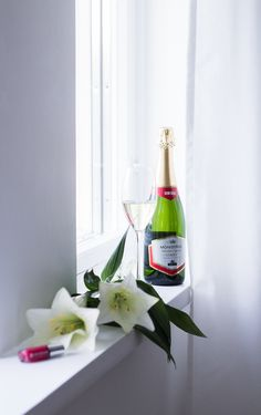 Red nails, sparkling wine, fresh flowers via Coffee Table Diary