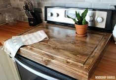 a DIY wooden stove top cover and add more counter space to your kitchen! Make a DIY wooden stove top cover and add more counter space to your kitchen! Diy Tumblr, Kitchen Furniture, Kitchen Decor, Kitchen Ideas, Wooden Kitchen, Cheap Furniture, Furniture Plans, Pallet Furniture, Kitchen Tips