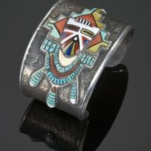 Preston Monongye, Tufacast cuff bracelet, with mosaic inlay, Pahlik Mana, Moisture Woman Katsina design, ca. 1970s, Gallup, NM; Photo Archive « Waddell Trading Company.