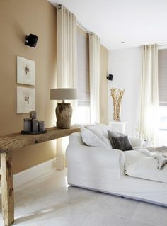soft beige and white neutrals in the living room with rustic elements