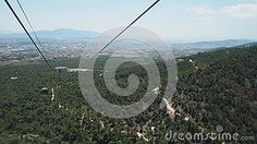 Taken on a cable car (teleferic) descending from Mount Parnitha with view across Athens, Greece.