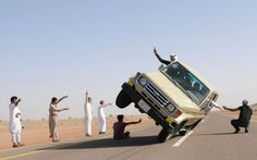 "Saudi youths demonstrate a stunt known as ""sidewall skiing"" in the northern city of Hail"