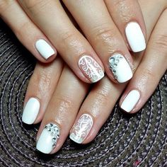 Instead of painting on of your nails all white, you can just try to create pictures like swirling leaves similar in this picture. Then add some diamonds on the nail beside it, crescent moon style.