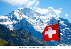 stock photo : Swiss flag on the top of Mannlichen (Jungfrau region, Bern, Switzerland)
