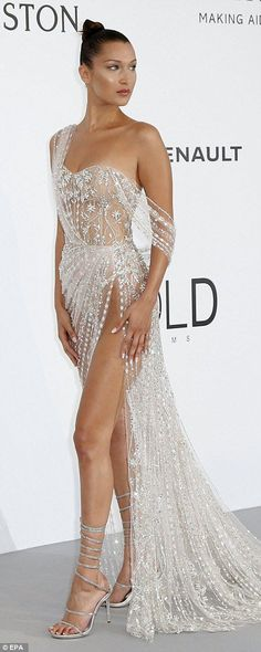 Posing up a storm: The silver sensation was a delight for the eyes as she showed off her phenomenal shape in the gown