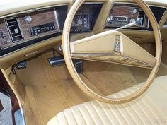 1973 Oldsmobile Delta 88 Royale.  Ours had a black cloth interior and black dash.
