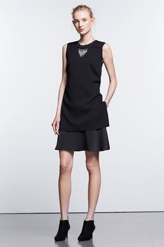 This layered shift dress gives the illusion of separates with an elongated, textured bodice over a polished skirt. Find the Simply Noir collection of little black dresses from Simply Vera Vera Wang, only at Kohl's. Available in women, women's plus and petites.