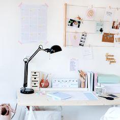 How about an organized work place? desk,lamp,calender,postcards,mug,creative