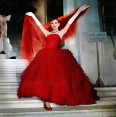 1950s Audrey Hepburn in red ball gown with sleeveless rusched bodice and thousands of layers of organza layers on super full ball gown, matching shawl, red ballet flats + great long silk gloves.