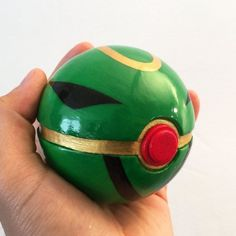 Rayquaza Ball. This was made for a customer in Singapore who is also one of the top junior players!  You can order your own custom pokeballs at philafofalofdesigns.etsy.com  #Pokemon #pokeball #pokeballs #rayquaza #hoenn #pokemon20 #legendarypokemon #kyogre #groudon #oras #pokemonruby #pokemonsapphire #omegaruby #alphasapphire #pokemonoras #custompokeball #handmadepokeball #crafts #etsy #handmade #prop #cosplay #replica #cosplayprop #pokemoncosplay