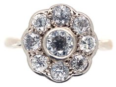 This style of ring is always popular, and this one is a great example of a diamond daisy ring. The centre diamond is slightly raised giving it a good form. It was made circa 1920 and would make a lovely engagement ring.