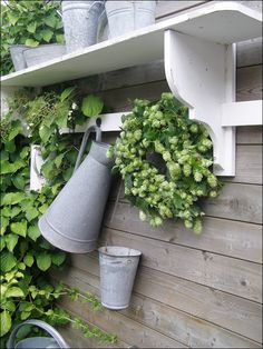 screw galvanized vase to the wall for cut flowers, etc.