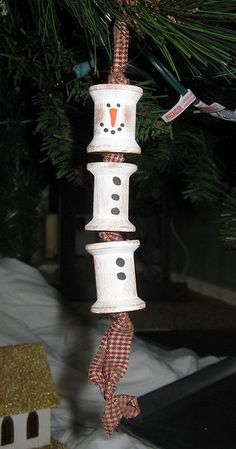 Wooden spool snowman ornament. Add charm to any Christmas tree or gift box, and make charming and thoughtful holiday presents for friends and family members.