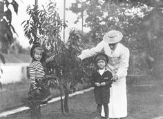 A lady-in-waiting with the Tsarevich Alexei Nikolaevich, and his sister, Anastasia Nikolaevna. I've always thought Anastasia resembled her mother, more than her siblings. But in this particular photo, she looks so much like Nicholas when he was about the same age!