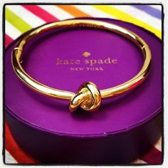 kate spade - tying the knot..adorable bridesmaid gift! Thanks for helping me tie the knot - i received a similar bracelet for being a bridesmaid. Mine was black with gold lining with a bow. Bride had all gold with a bow. Very cute! We wore ours on the wedding day #bowgear