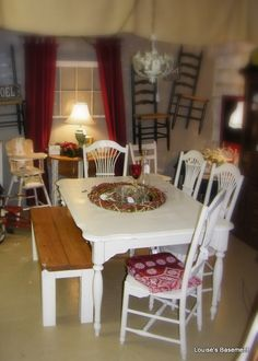 White Kitchen Table & White Chairs. I bought this table & 4 chairs at a garage sale and painted them white.